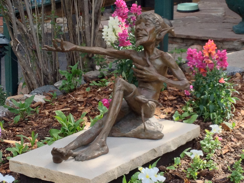 Whimsical garden fairy sculpture at Highland Haven
